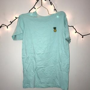 men mint shirt with pineapple design